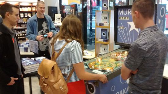 Chris Poyntz (left) and Lukasz Romanowski (right) from the UK Pinball League join Will and Rosie from Penguin Random House