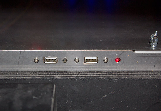 Two USB ports on the front of the metal box