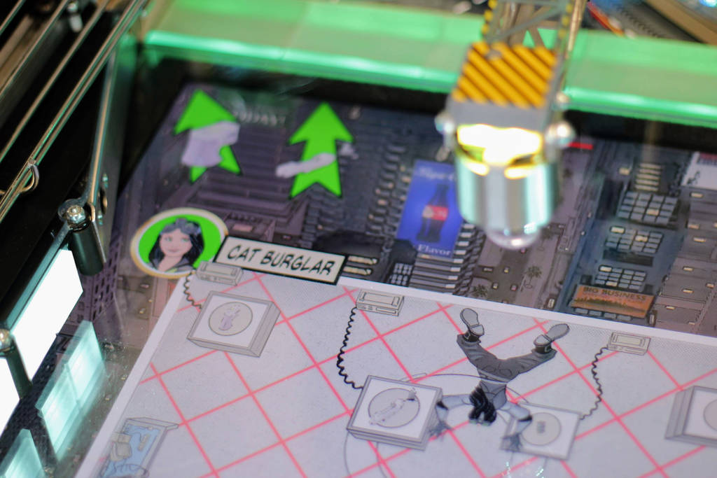 The crane extends over and interacts with the playfield LCD display