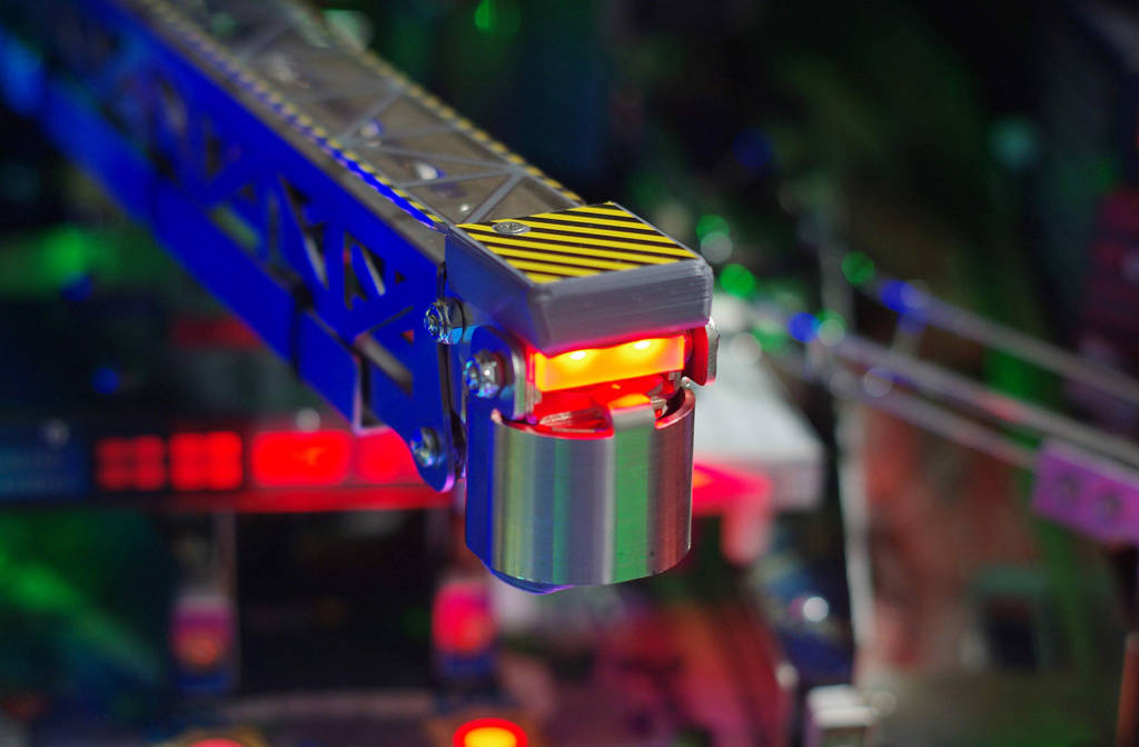 The RGB LEDs at the end of the crane, plus it can sense hits to the arm