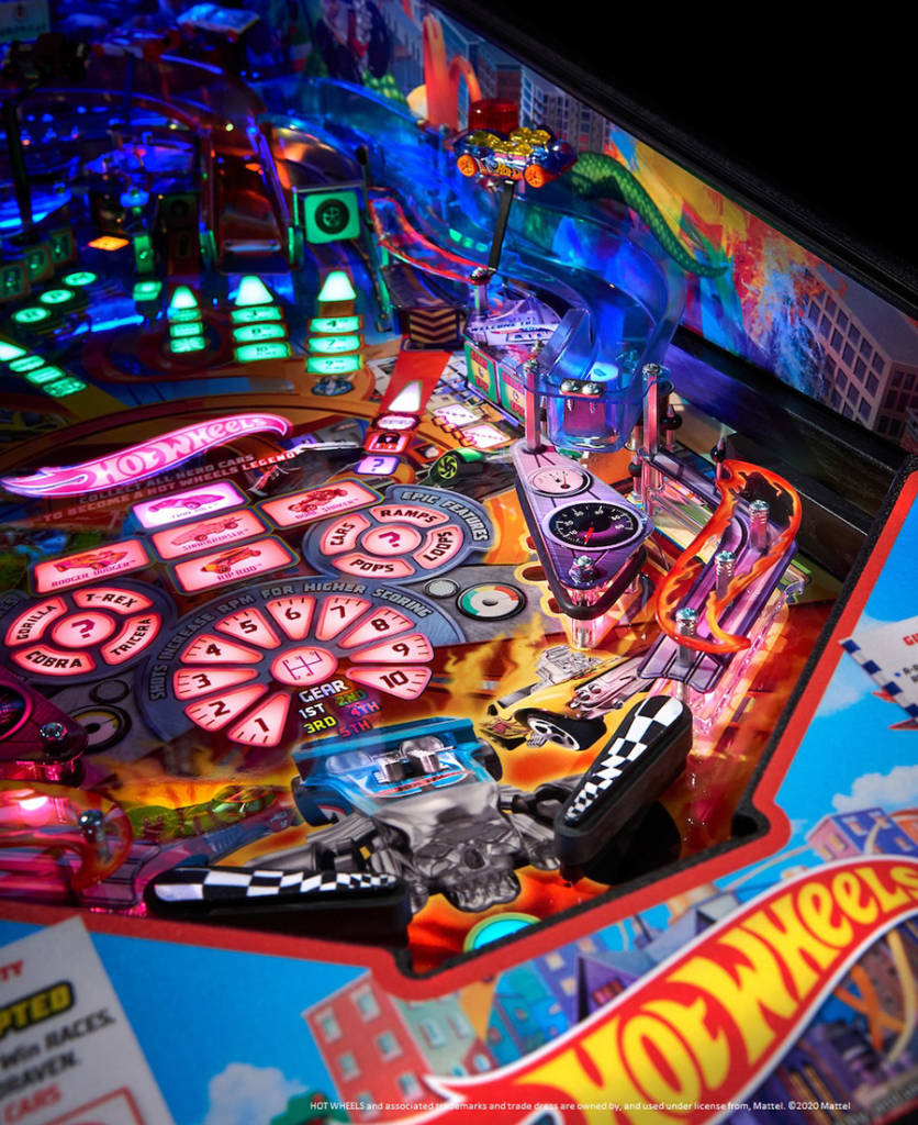 Some of the many RGB-lit inserts on the playfield