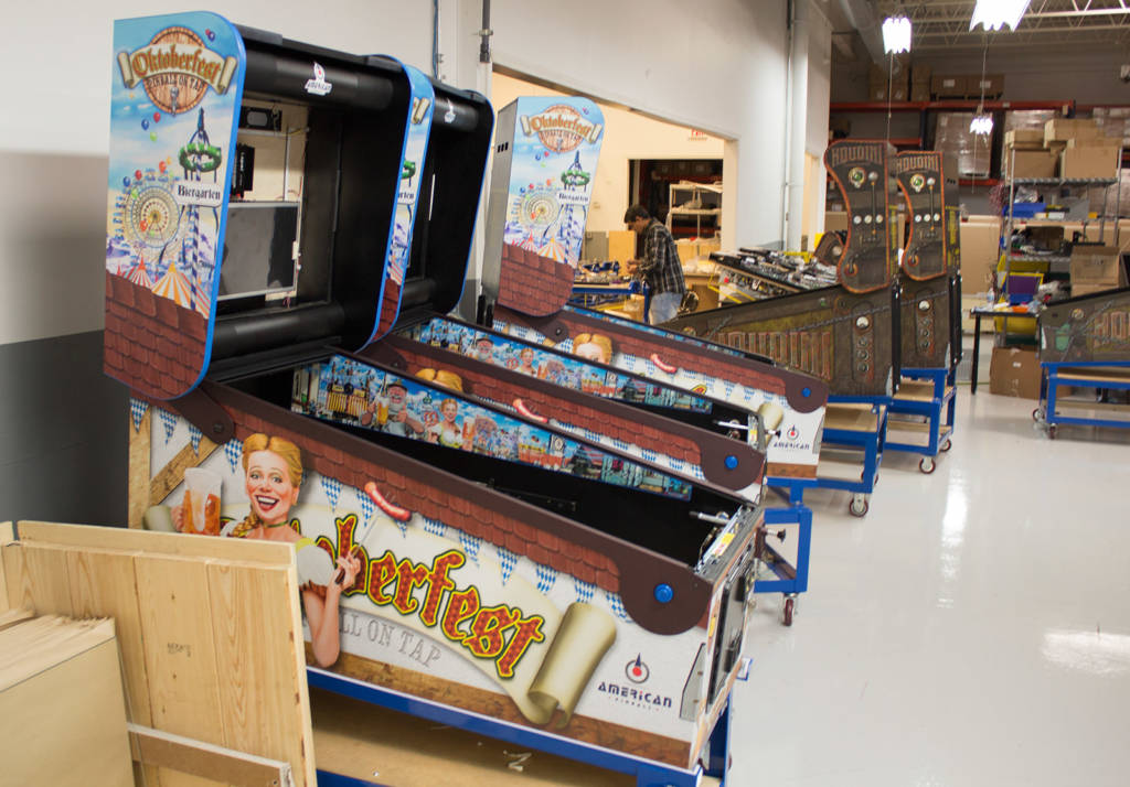 Oktoberfest cabinets alongside Houdini games in the factory