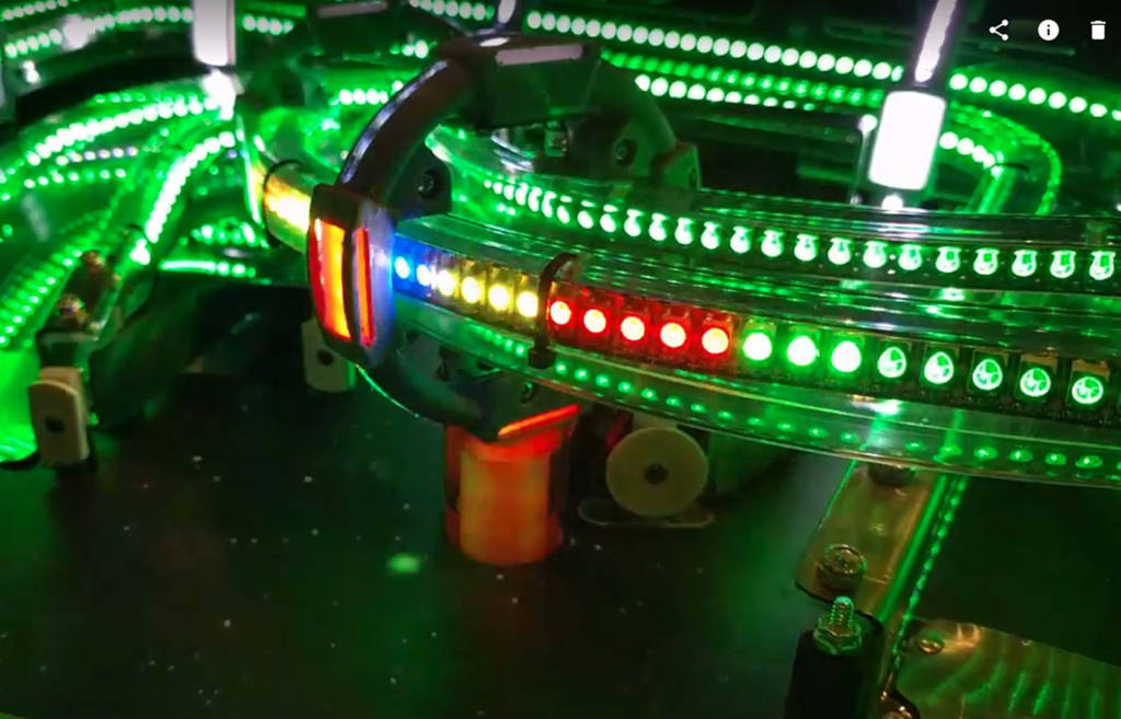 Some of the LED-lit ramps on the Cosmic Cart Racing upper playfield module