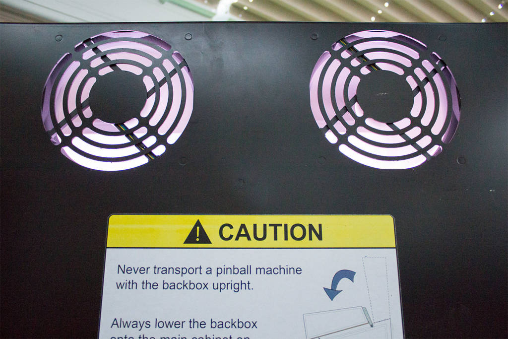 The two backbox fans and warning label