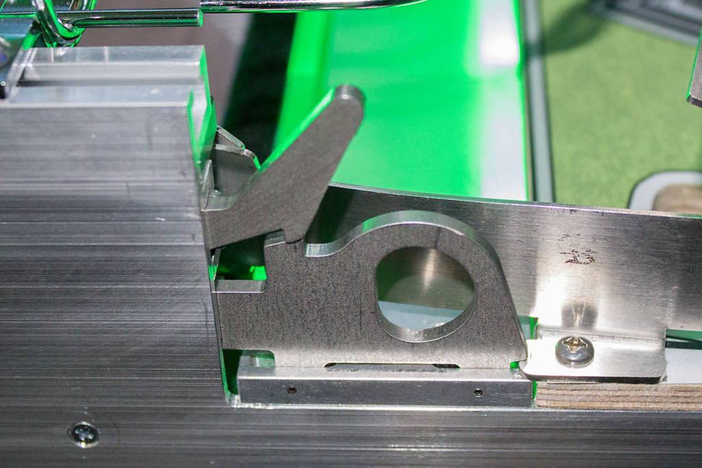 Upper playfield module latch