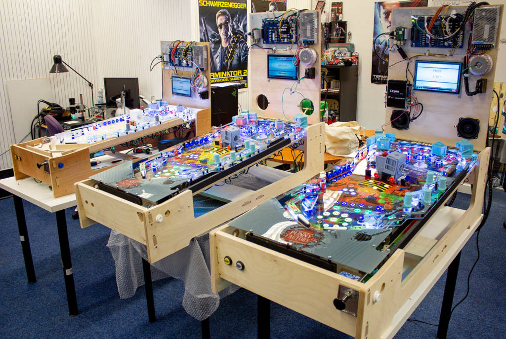 The original playfield (left) alongside the two prototypes which will ship to Andrew