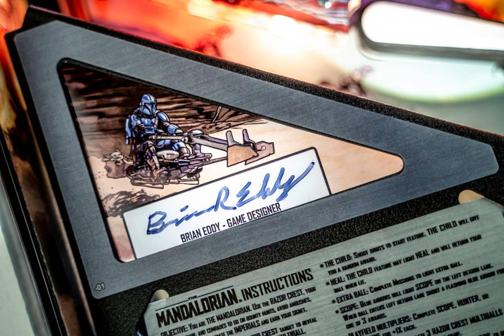 Game designer Brian Eddy's signature is on the left panel