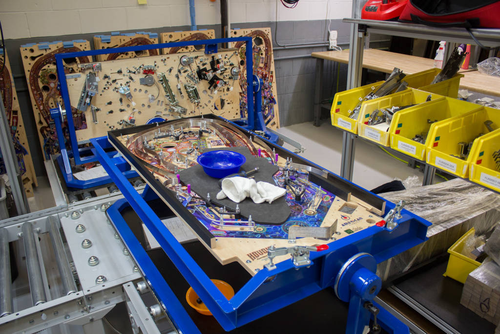 The Houdini playfield with flat rails and ball guides added goes onto the line