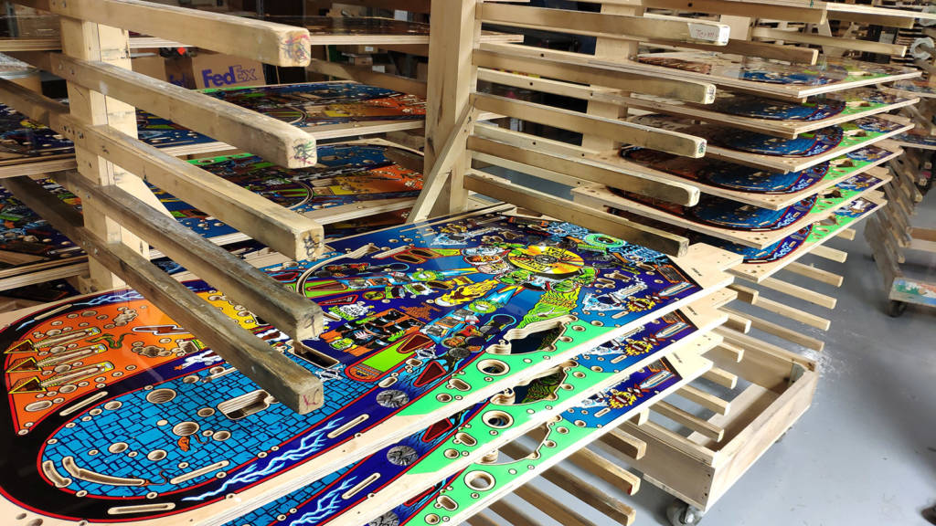 Racks of clearcoated Monster Bash playfields