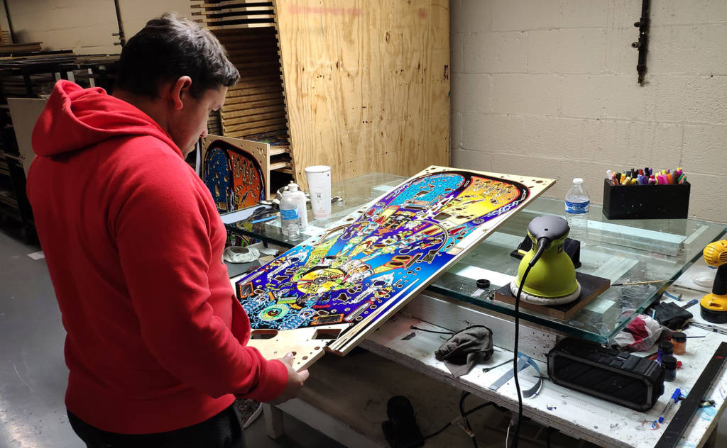Each playfield is inspected for any flaws in the printing, alignment or clearcoat