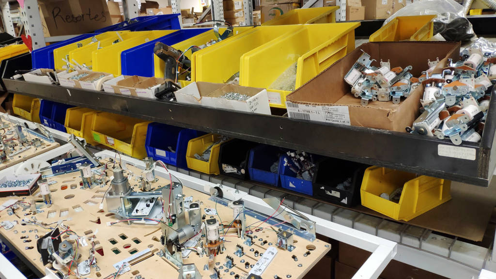 Assemblies are loaded into sloping trays above the line for use when needed