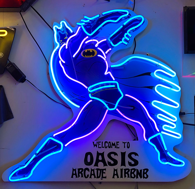 Batman welcomes you to the Oasis Arcade AirBnB