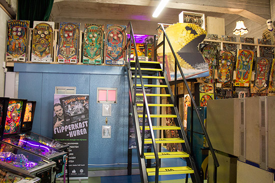 Stairs lead up to the electromechanical and flipperless games