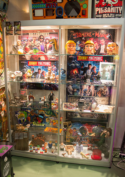 A display case packed with pinball artefacts