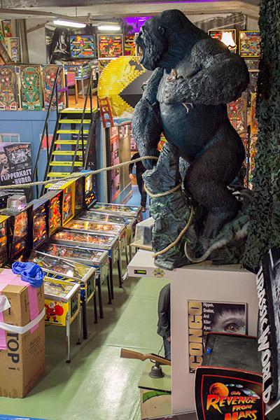 A grey gorilla 'apes' the Congo toy and artwork