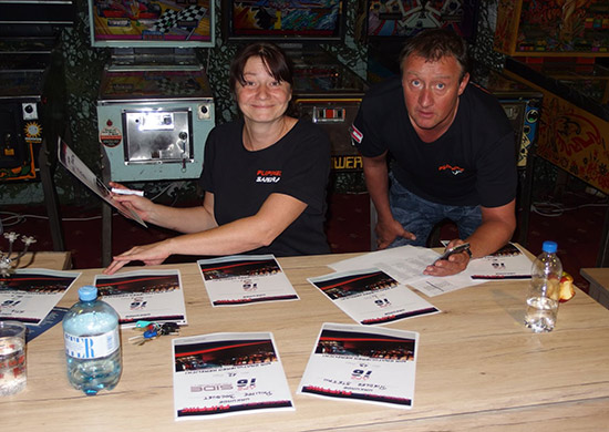 Sandra and Bernd Prucher preparing the tournament certificates