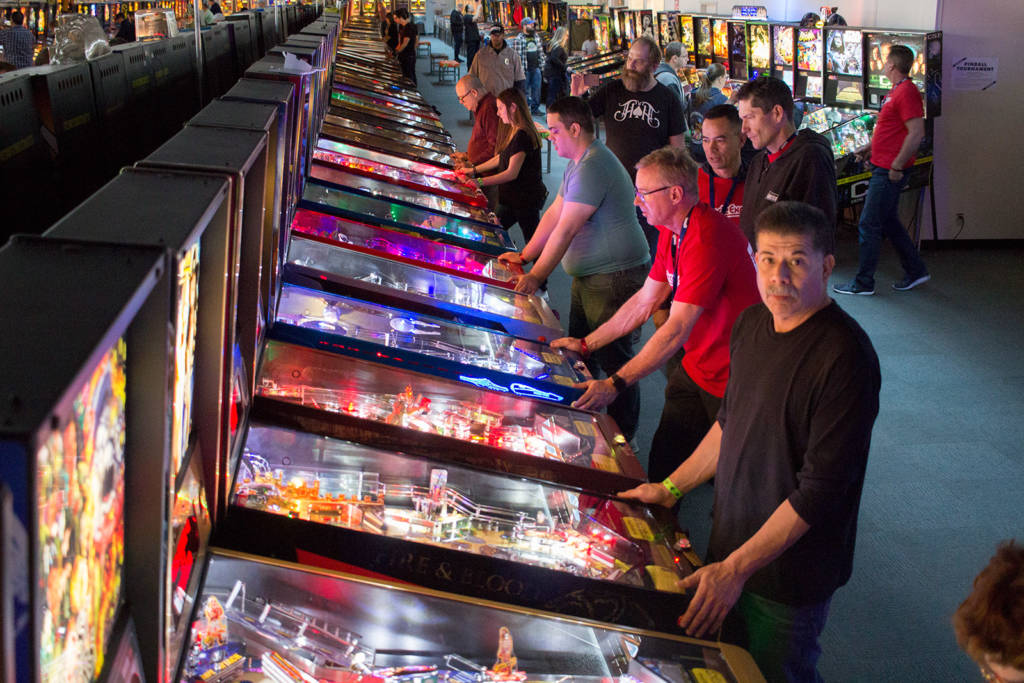 Players on some of the Stern Pinball machines