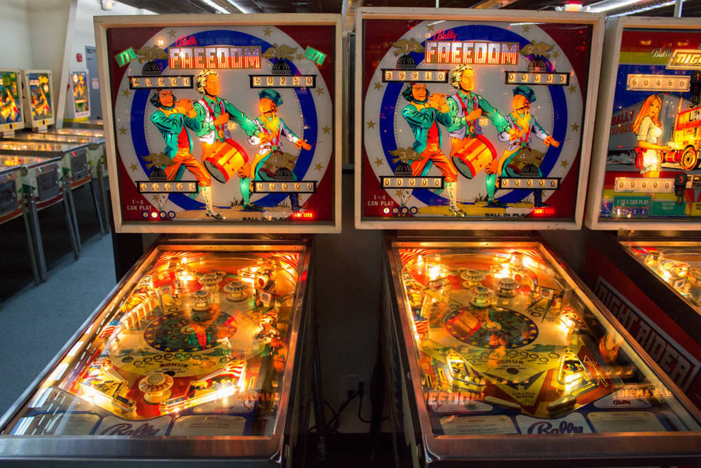 Two Bally Freedom machines - a prototype with a pop bumper between the flippers and the production one without