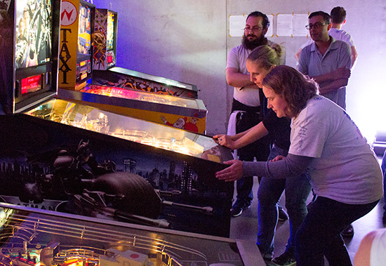 The PinballLadies playing split-flippered in the Team Tournament