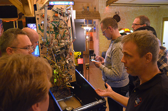 Andy Hengstebeek, Freddy's right hand pinball man, shows the underside of the playfield