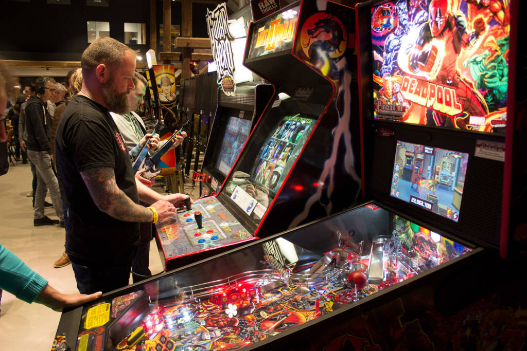 Guitar Hero and Mortal Kombat II video games alongside a new Deadpool Pro pinball