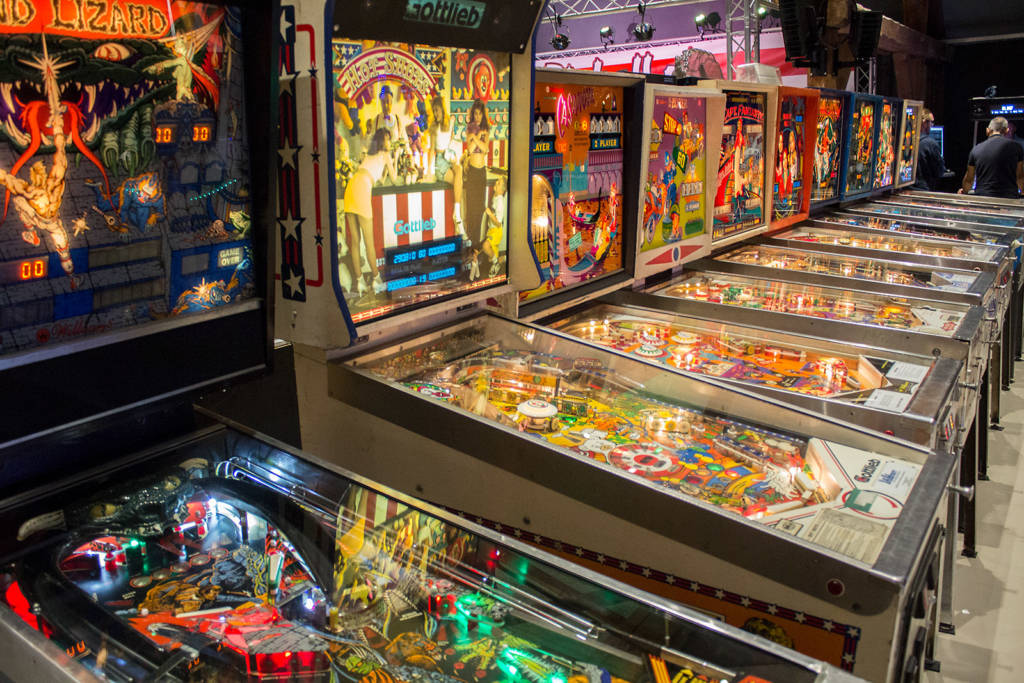 Older free play pinballs further down the row