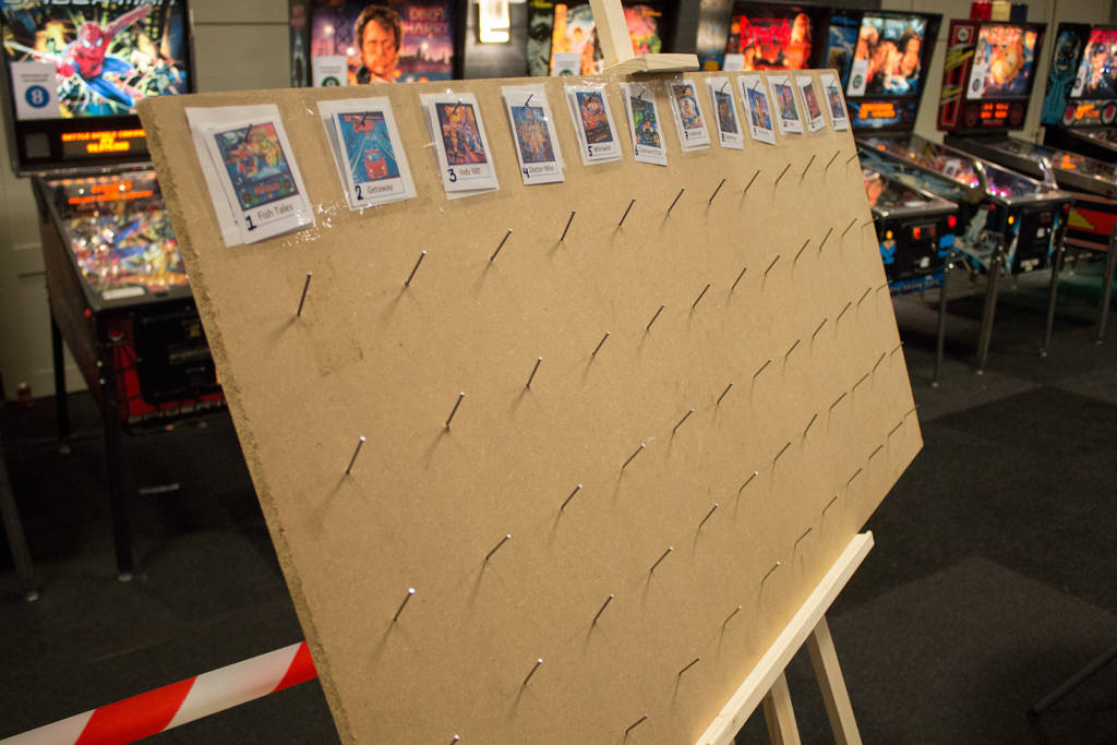 Players put their player badge on the peg board against the machine they wished to play