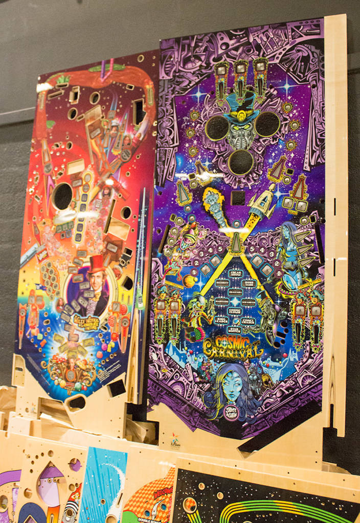The new Willy Wonka Limited Edition playfield alongside the ill-fated Cosmic Carnival playfield from Suncoast Pinball