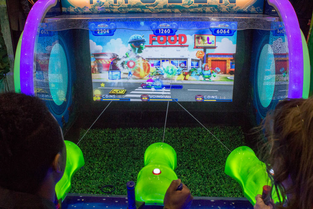 Multi-player big-screen shooting games were popular but this one added water to the mix