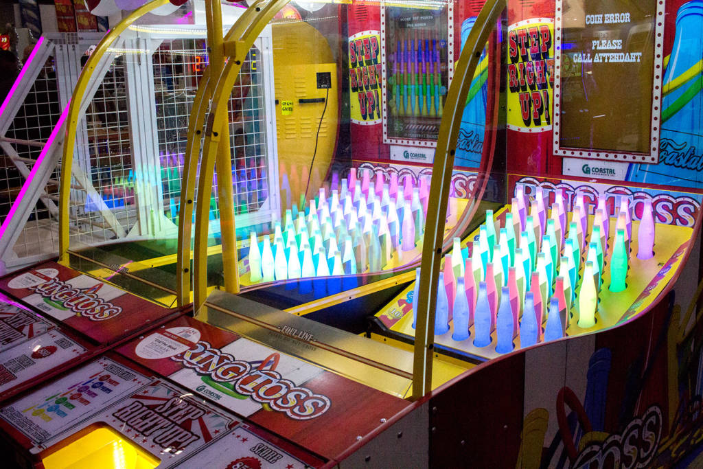 Two Ring Toss games - the floor rises to release the rings from the bottles at the end of the game