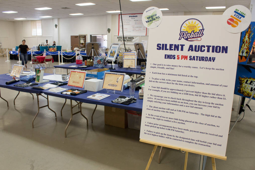 The tables with the silent auction items