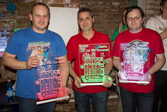 The top three in the Classics Tournament with their illuminated trophies