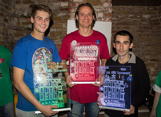 The top three with their illuminated trophies