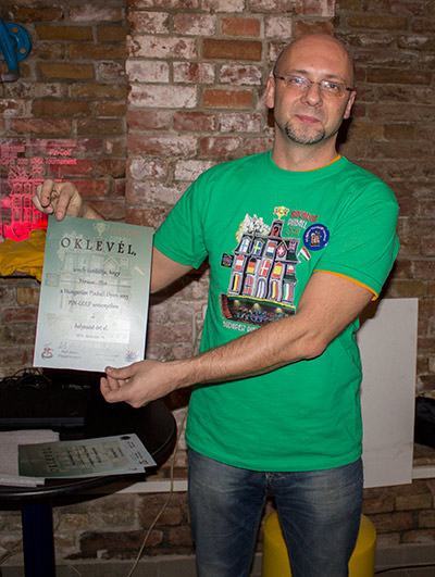 Gábor shows the third place certificate won by the absent Markus Stix