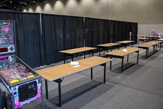 Surrounding the merchandise desk were numerous vendor tables