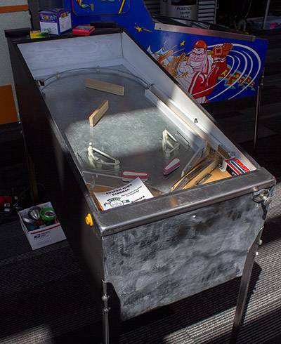 This custom pinball allows kids to explore what's under the glass
