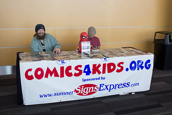 Out in the lobby, Comics 4 Kids were promoting comic books with free giveaways