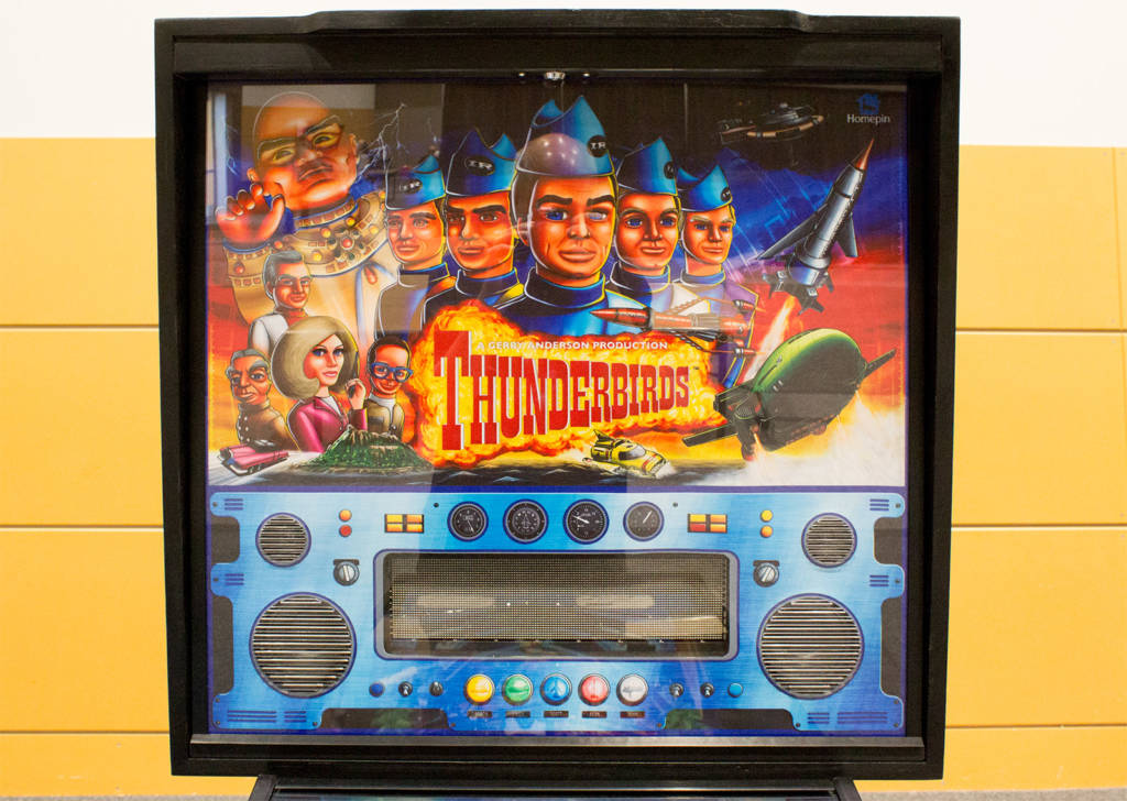 The Thunderbirds backglass which is all one piece
