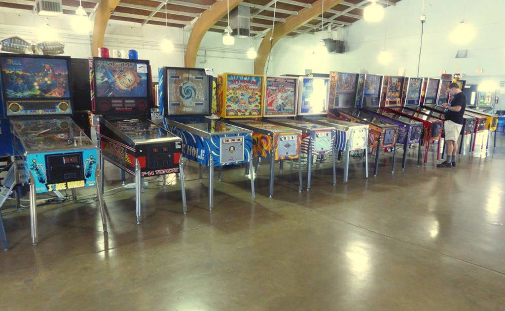 Another row of (mostly) electronic pinballs, with a couple of classic EMs mixed-in