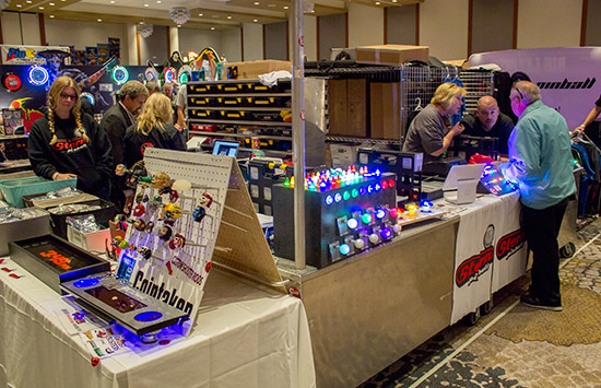 Custom shooter rods, flipper buttons and Stern merchandise on the CoinTaker stand