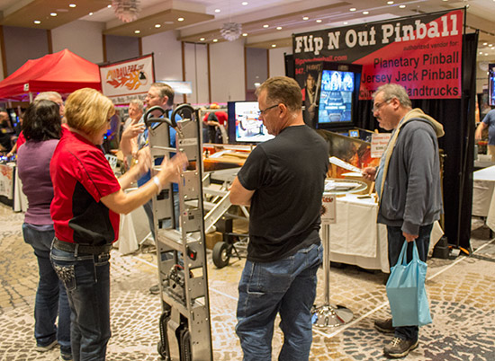 Behind ColorDMD was the Flip N Out Pinball stand featuring the Escalera hand trucks and lifters