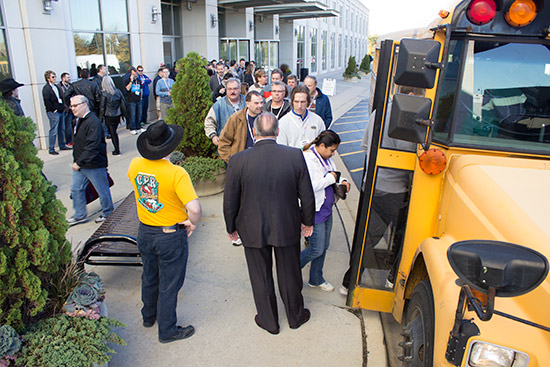 Expo guests board the first school bus