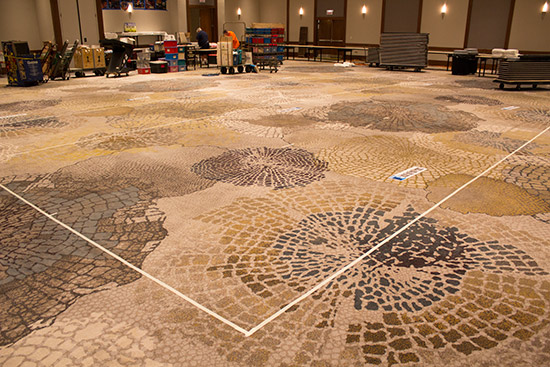 Tape on the carpet defines each vendor's space
