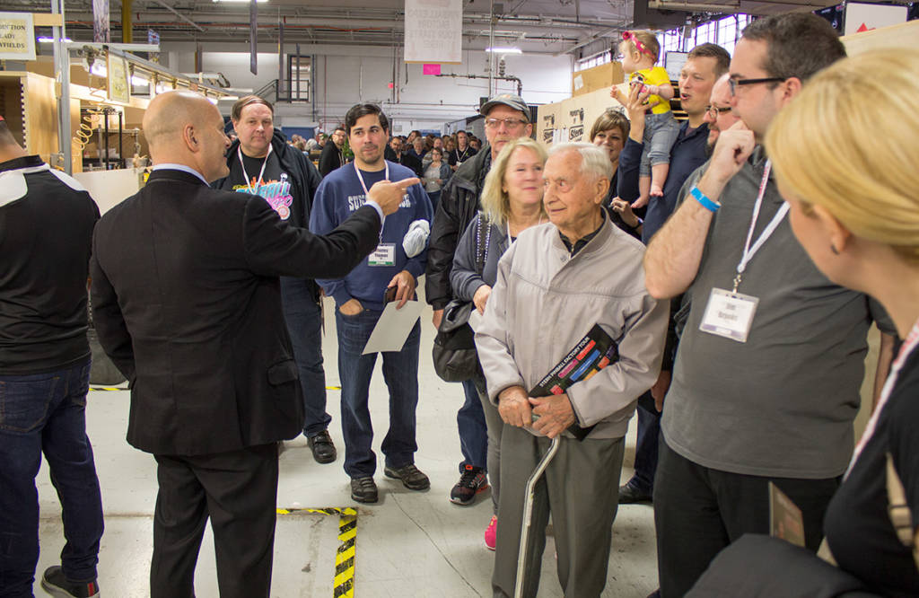 John Buscaglia leads a tour group around the Stern Pinball factory
