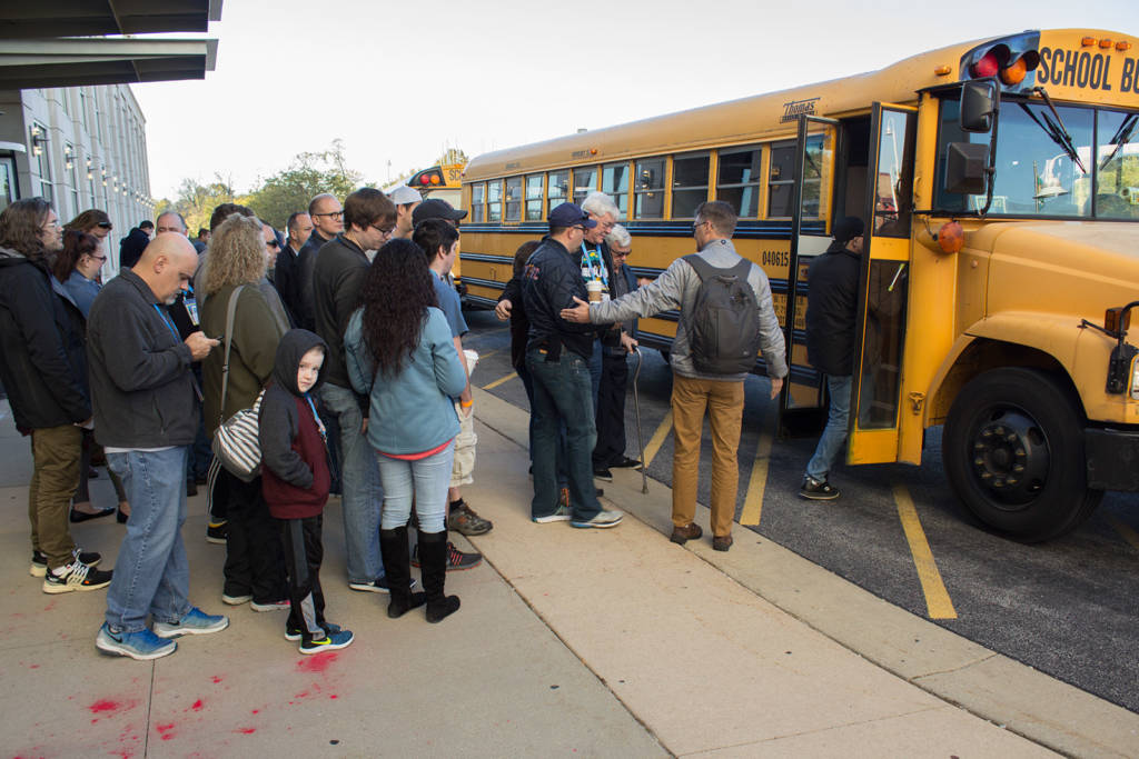 Stern Pinball factory tour guests board the bus for the trip to Elk Grove Village