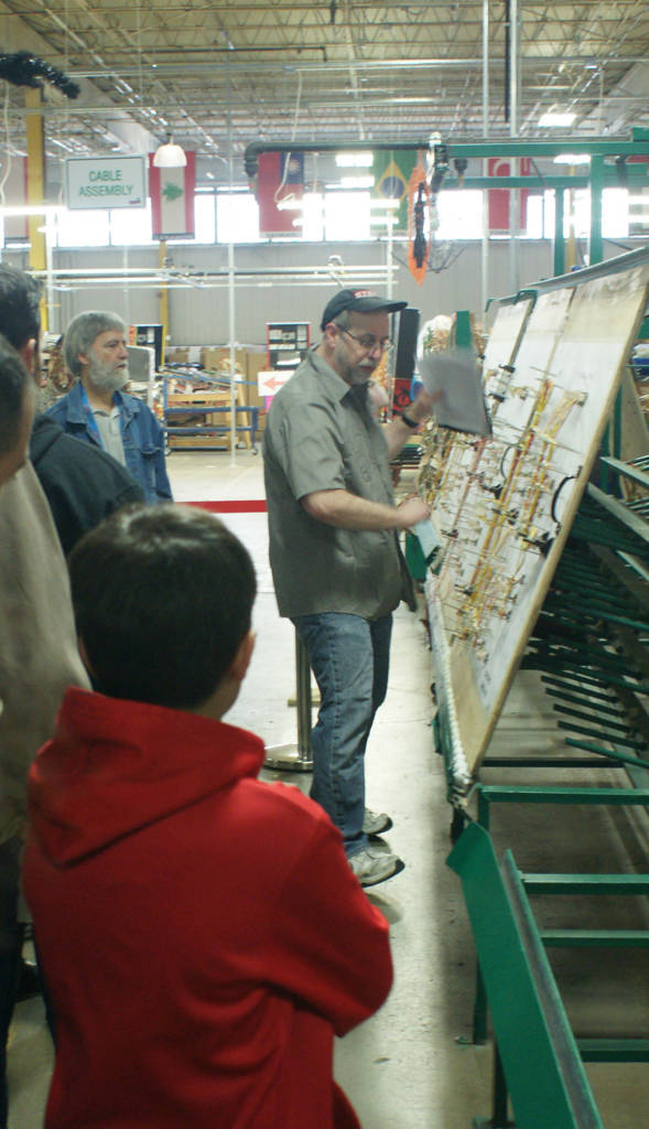 Dwight explains how the wiring looms are made