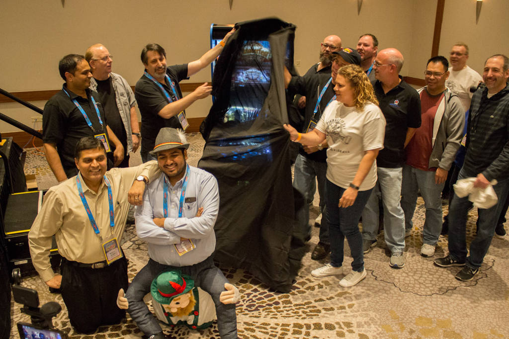Members of the American Pinball team unveil the game