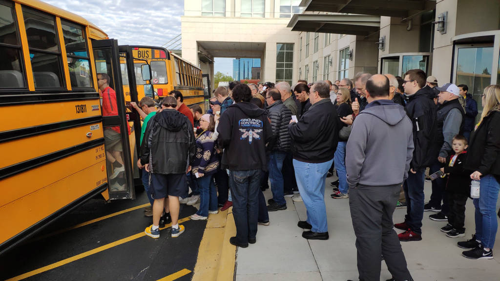 More buses arrive and take tour guests to the Elk Grove Village factory