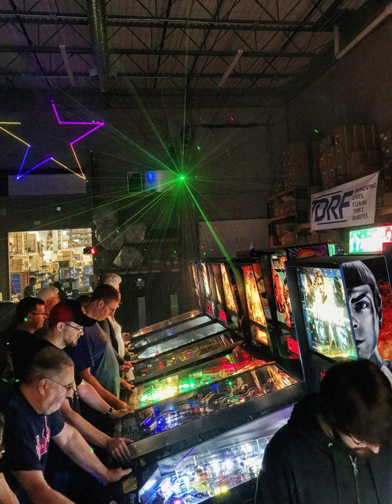 Lasers lit up the games and players in the darkened room
