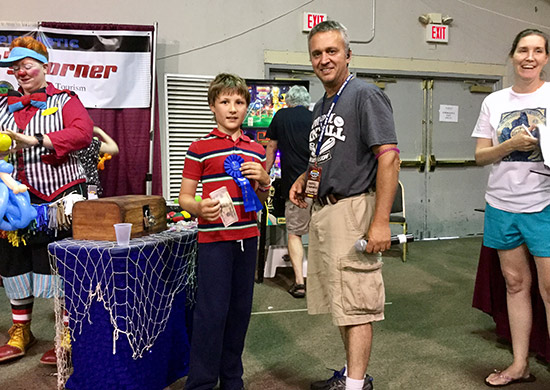 Pintastic Founder Gabriel D'Annunzio congratulates the winner of the Kids' Tournament